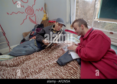 Young men living in temporary accommodation at Kennington squat. - Stock Photo