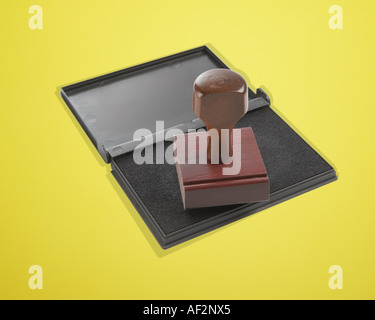 Red Rocket Stock Rubber stamp and pad on color background with clipping path - Stock Photo