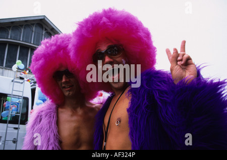 Wig Wearing Revellers At Gay Pride - Stock Photo