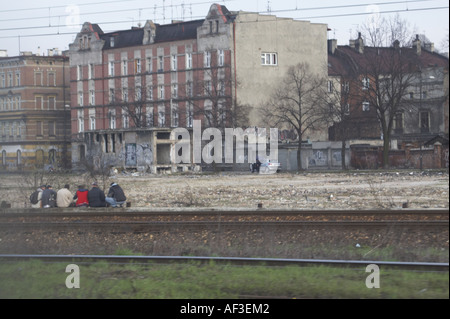 Upper Silesia Poland. People sitting on the tracks drinking alcohol - Stock Photo