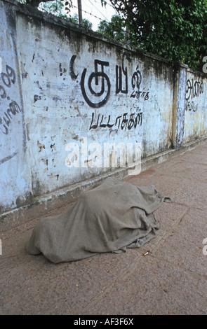 Homeless sleeping on sidewalk, India - Stock Photo
