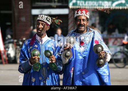 men in traditional dress in Marrakech s main square - Stock Photo
