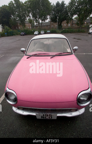 Pink and white two tone Nissan Figaro classic cult car - Stock Photo