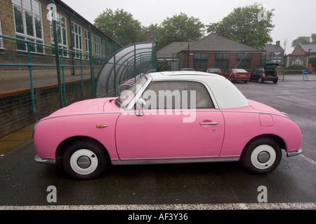 Pink and white two tone Nissan Figaro classic cult car japan - Stock Photo