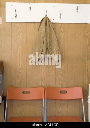 Coat on coat hook - Stock Photo