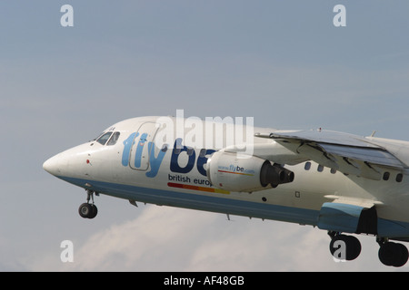 Flybe low cost airline Bae 146 jet airliner taking off - Stock Photo