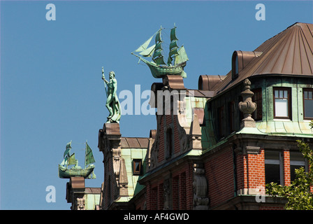 Sculptures made of copper at the gables of a typical old office buildung in Hamburg, Germany - Stock Photo