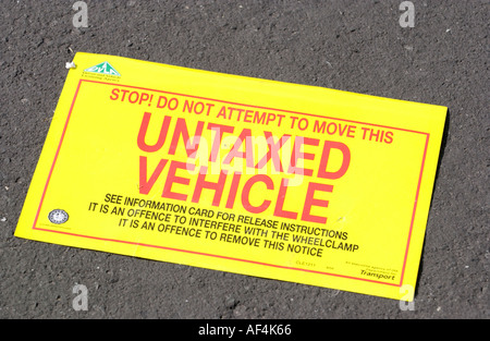 Window sticker removed from an untaxed vehicle in a DVLA operation in Newport South Wales UK - Stock Photo