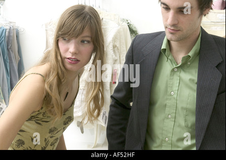 Close-up of a young couple in a clothing store - Stock Photo