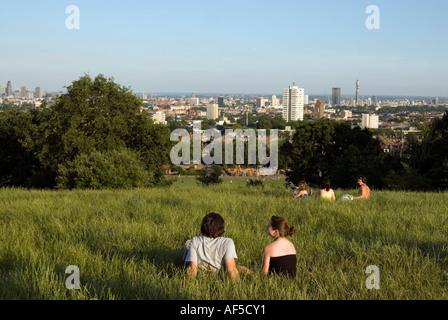 People enjoying the view at Hampstead Heath, London, England, UK - Stock Photo