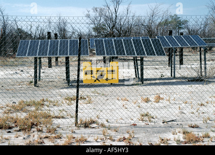 Solar panels generating electricity to drive a water pump near Savuti South Camp Chobe National Park Botswana - Stock Photo