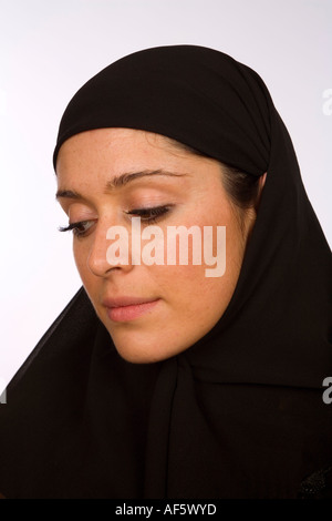 Close up head shot of a Muslim woman in a black hijab - Stock Photo