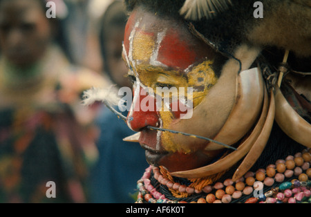 PAPUA NEW GUINEA PNG Australasia Portraits Men Tribesman with painted face and pierced nose - Stock Photo