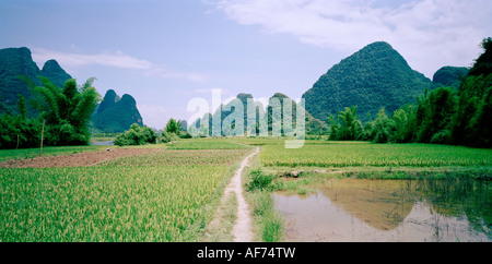 Landscapes World Travel. A landscape showing the mountains in Guilin in Yangshuo Guangxi in China in Asia. Adventure - Stock Photo