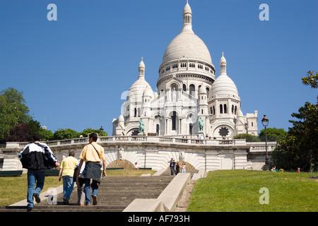 FRANCE Ile De France Paris Montmartre Tourists on steps leading up to basilica church of Sacre Couer Sacred Heart - Stock Photo