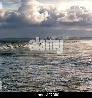 England. Yorkshire. Redcar and Cleveland. Stormy sky over sea coastline with steel plant . - Stock Photo