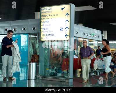 Airport Departure Lounge Duty Free Shop and Information Board Catania Airport Italy - Stock Photo