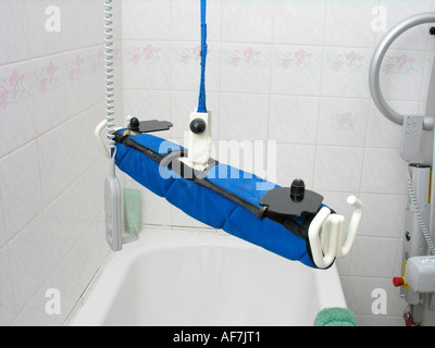 windsor ceiling hoist disability equipment in the bathroom for a patient or disabled person - Stock Photo