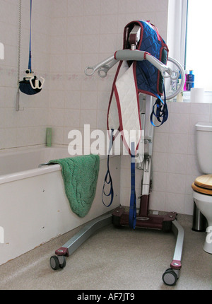 a portable hoist and windsor ceiling hoist disability equipment in the bathroom for a patient or disabled person - Stock Photo