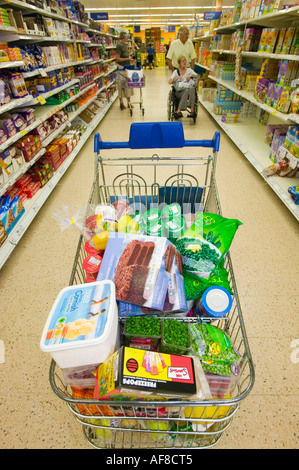 a shopping trolley full of food in a Tesco's supermarket in Carlisle, cumbria, UK - Stock Photo