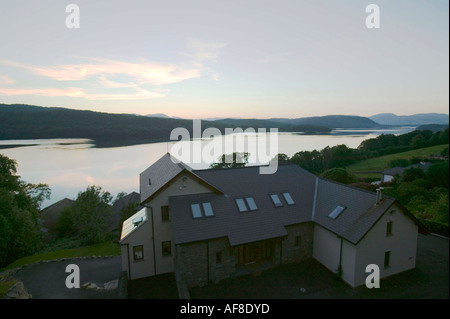 a large expensive house overloooking  lake windermere, Lake district, at dusk, Cumbria, UK - Stock Photo