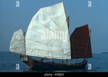 Stern & side view of traditional genuine old local sailing junk in the late 1970s in Victoria Harbour Hong Kong - Stock Photo
