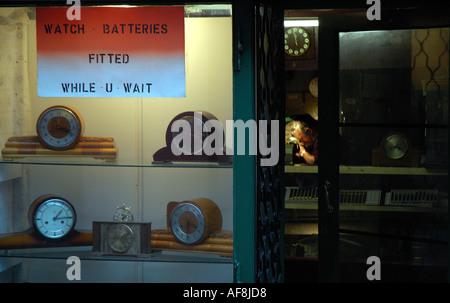 Man repairing watches - Stock Photo