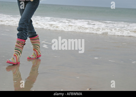 A Stock Photograph of a Woman in Wellies on a beach in Scotland - Stock Photo