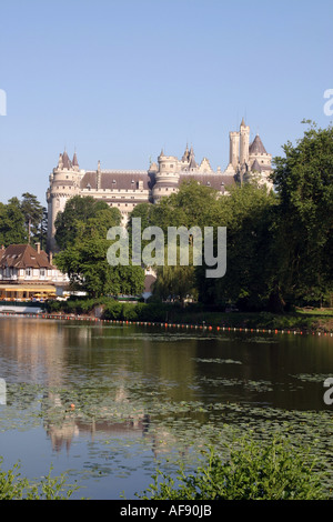 A Stock Photograph of the Castle of Pierrefonds in France Seen from the Town Lake - Stock Photo