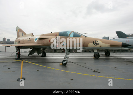 Israel Aircraft Industries Kfir on disply on the flight deck at the Intrepid Sea Air Space Museum - Stock Photo