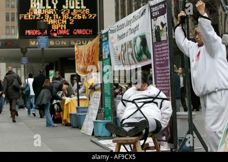 Members of Falun Gong Falun Dafa protest outside madison square garden new york city new york USA - Stock Photo