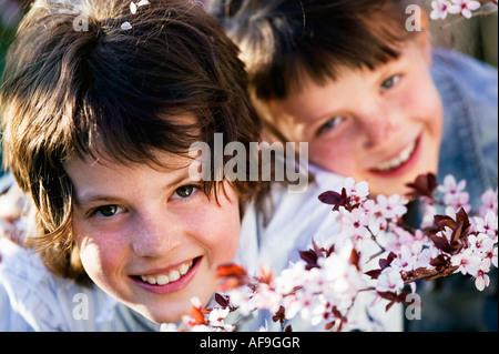 Two children outdoors, portrait - Stock Photo