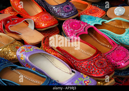 Colorful hand made Indian slippers for sale at an outdoor market - Stock Photo
