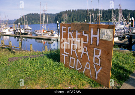 A Crab for Sale sign in the town of Florence and the Florence Harbor on the Oregon coa - Stock Photo