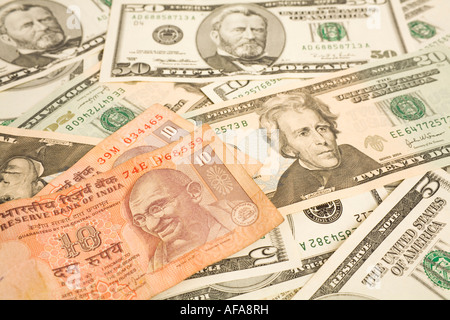 Indian rupee notes on top of dollar bills - Stock Photo