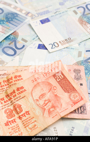 Indian rupee notes on top of euro bills - Stock Photo