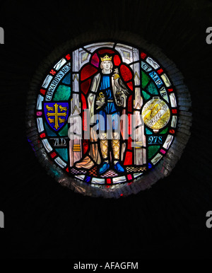 Stained Glass Window in the ruins of Shaftesbury Abbey, Shaftesbury, Dorset, England, UK - Stock Photo