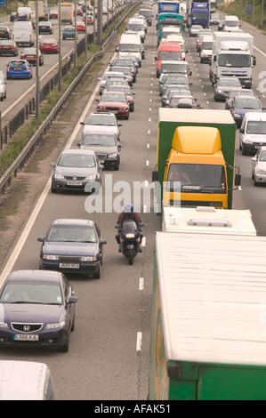 traffic congestion on the M1 motorway at loughborough due to sheer volume of traffic with a motorbike riding between - Stock Photo