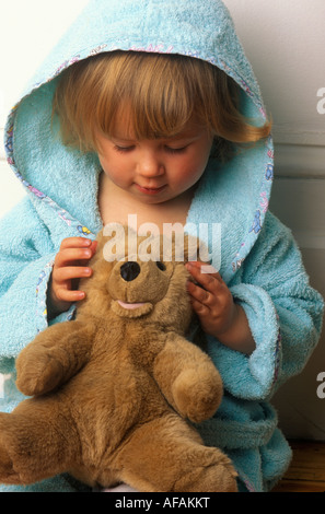 toddler with teddy - Stock Photo