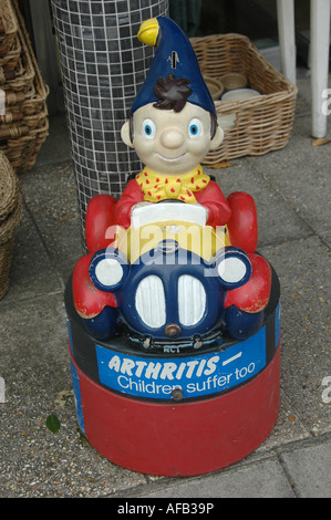 Lymington .Hampshire .Collection box for children with arthritis in shape of Noddy in his car on the street - Stock Photo