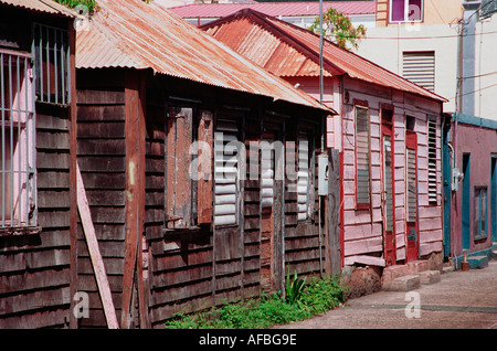 Typical colorful houses on a back street in Charlotte Amalie St Thomas U Virgin Islands - Stock Photo