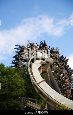 Riders inverted on Nemesis ride Alton Towers UK - Stock Photo