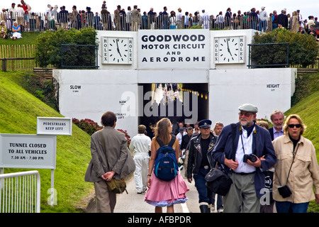 Goodwood Revival crowd passing through a tunnel under the motor racing circuit. west Sussex UK 2007 - Stock Photo