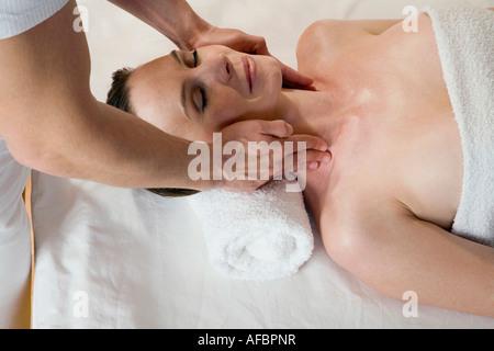 Woman receiving facial massage - Stock Photo
