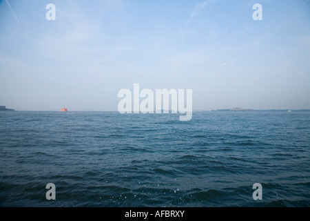 Hudson River with Statue of Liberty in Distance - Stock Photo