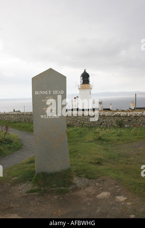 Welcome Stone and Dunnet Head Lighthouse North Coast of Scotland - Stock Photo