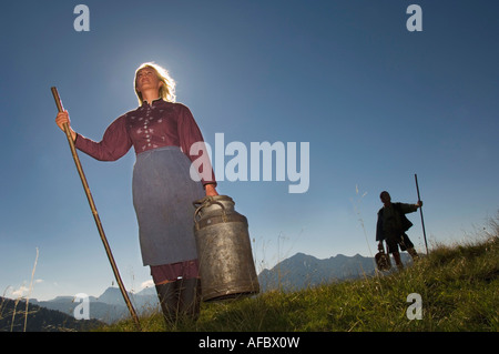 Couple in mountains holding crook - Stock Photo