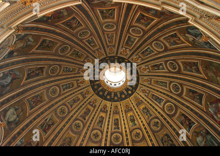 The decorative interior of the dome of St Peters Basilica in the Vatican - Stock Photo