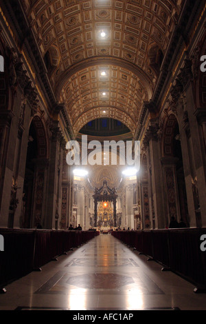 Interior of St Peters Basilica in the Vatican, with the Papal Altar in the background - Stock Photo