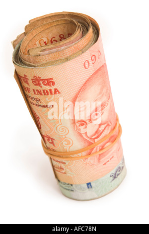 Roll of Indian Rupees isolated against a white background - Stock Photo